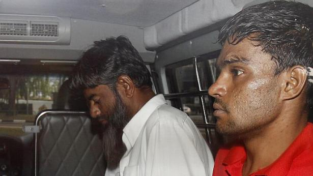 Two Pakistani men charged with murder over legless body in suitcase